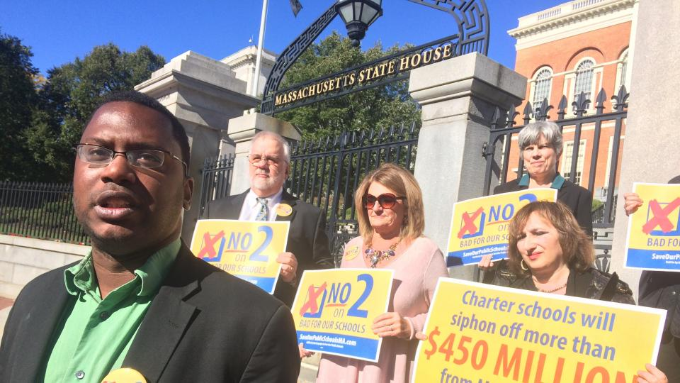 Somerville School member Andre Green was one of a handful of local school committee members that protested outside the State House Monday.