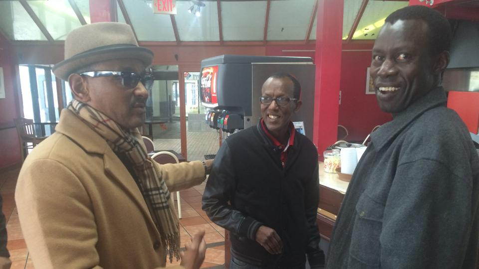 Abdillahi Abdirahman (center), who owns a social hub for Boston-area Somalis, says the American political system will keep President Trump in check.