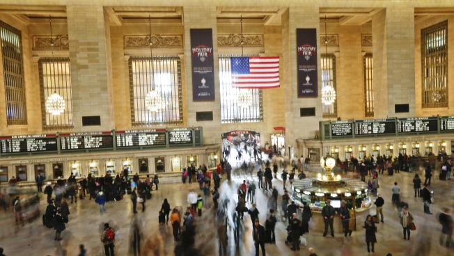 Are you one of these busy New York commuters? Then people might view you favorably (AP Photo/Frank Franklin II, File)