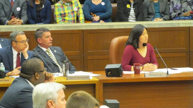 Boston City Councilors hear testimony on development petition.