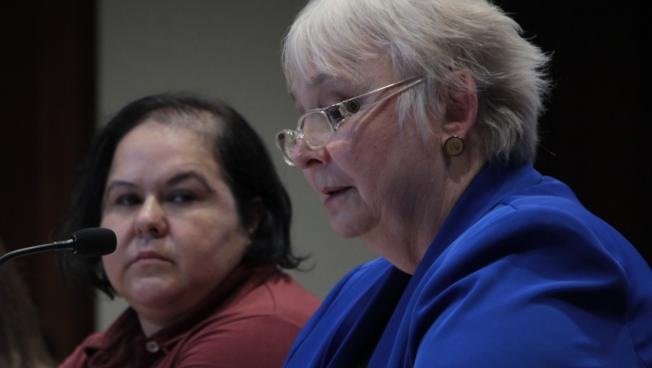 Alejandra Duarte (left) listens to Linda O'Connell (right) from the group MotherWoman.
