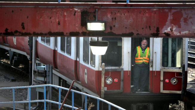 MBTA Board Votes To Privatize Bus Maintenance, Slash Spending On Commuter Rail and RIDE