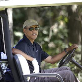 President Obama plays golf on Martha's Vineyard in 2014.