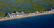 Homes along Salisbury Beach in Massachusetts and neighboring Hampton Beach in New Hampshire face the Atlantic Ocean and are backed by miles of marsh. (Lauren Owens Lambert/GroundTruth)