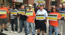 MBTA bus maintenance workers rallied outside the T's board meeting Monday.