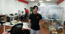 Quang Le, owner of Smartphones Beats Inc. standing in shop