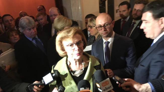 Senate President Harriette Chandler, surrounded by nearly every Democratic Senator, announced that she will remain president for the rest of the year.
