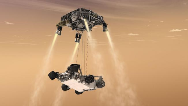 An artist's rendering of a sky-crane maneuver during NASA's Curiosity rover landing. The Mars 2020 rover will use a similar landing system.