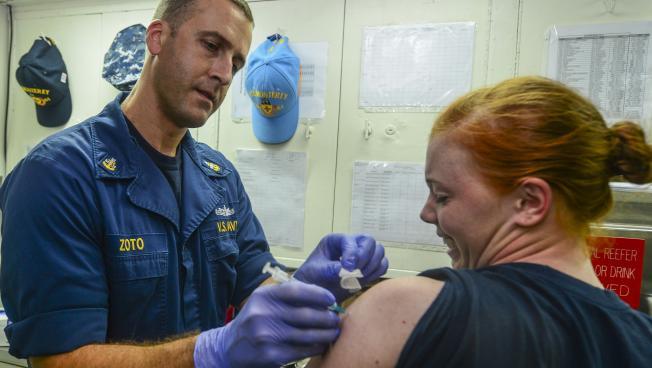 A sailor gets a flu shot aboard the USS Monterey