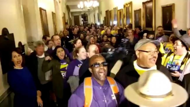 Low-wage workers gathered at the State House to demand a $15/hr minimum wage.