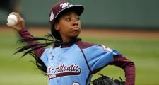 Pennsylvania's Mo'ne Davis delivers a pitch in the fifth inning against Tennessee at the 2014 Little League World Series tournament in South Williamsport, PA.